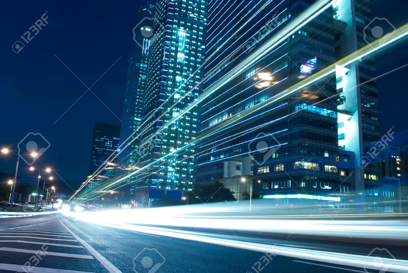 The urban landscape at night and through the city traffic - 10259930