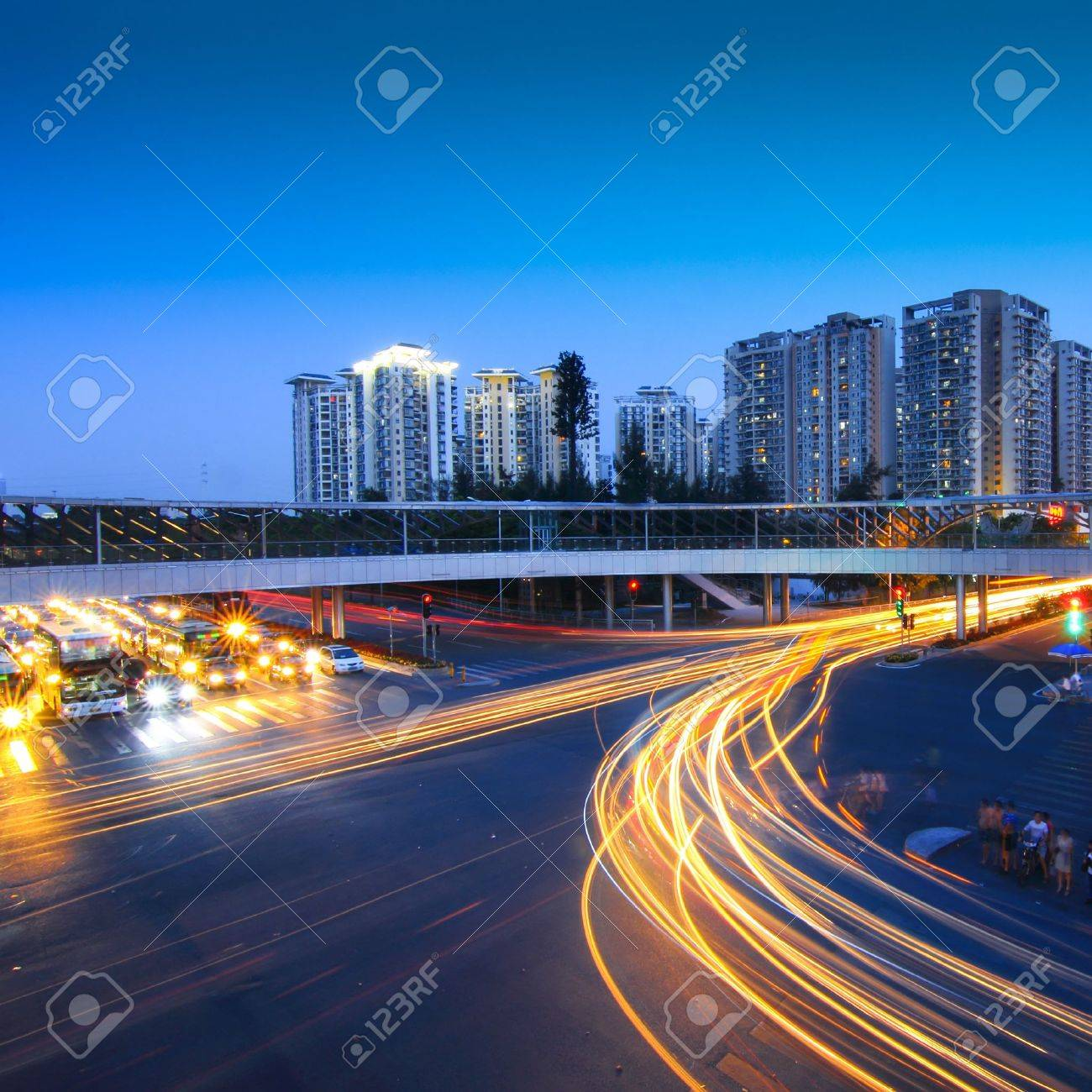 road with car traffic at night and blurry lights showing speed and motion Stock Photo - 10642080