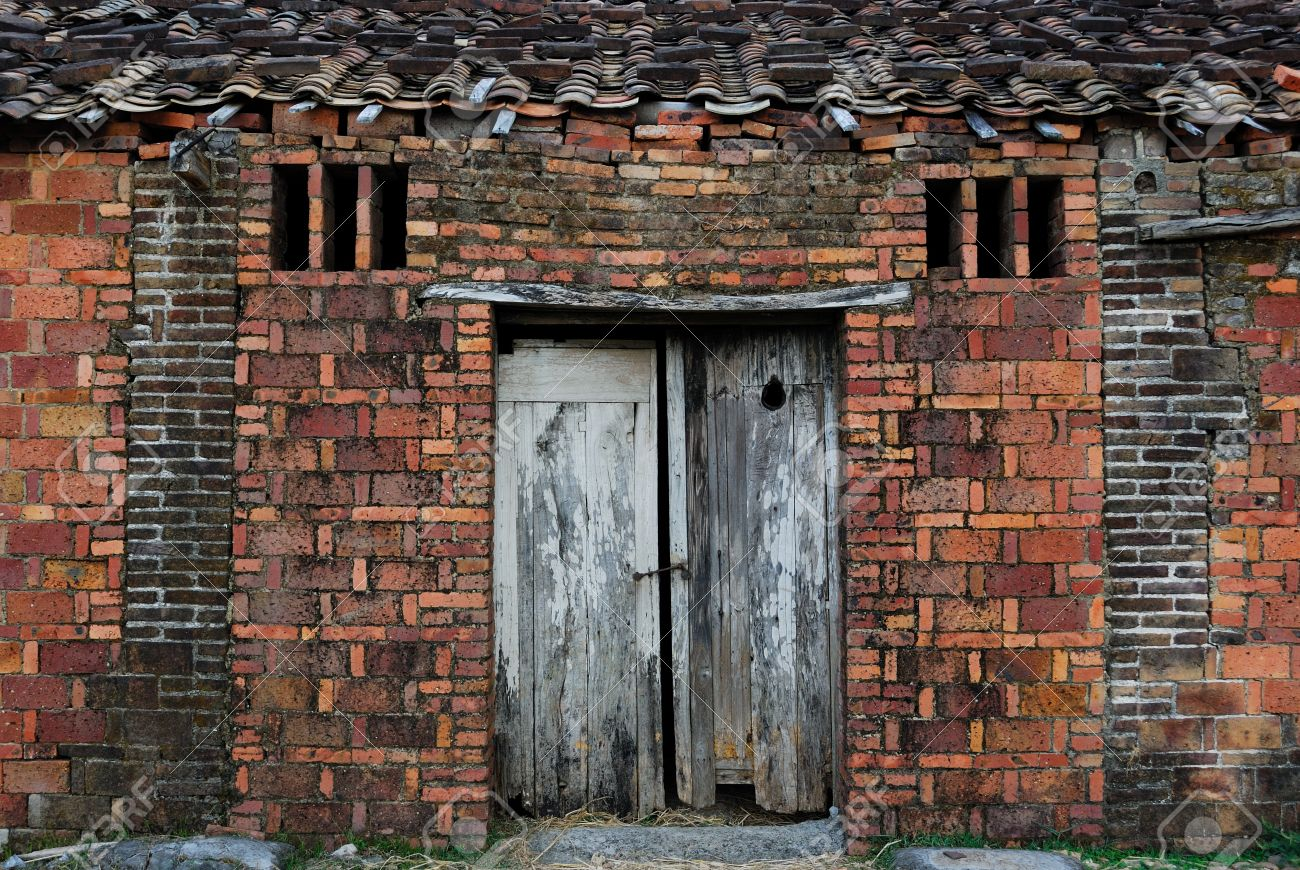 Severe corrosion of the mud-brick hut weathered facades, Stock Photo - 11113255
