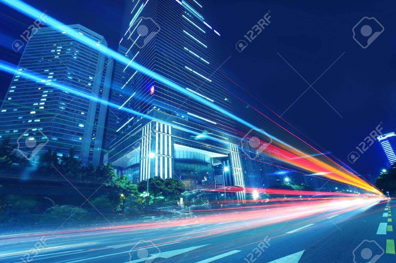 The traffic light trails in the street by modern building Stock Photo - 12548669