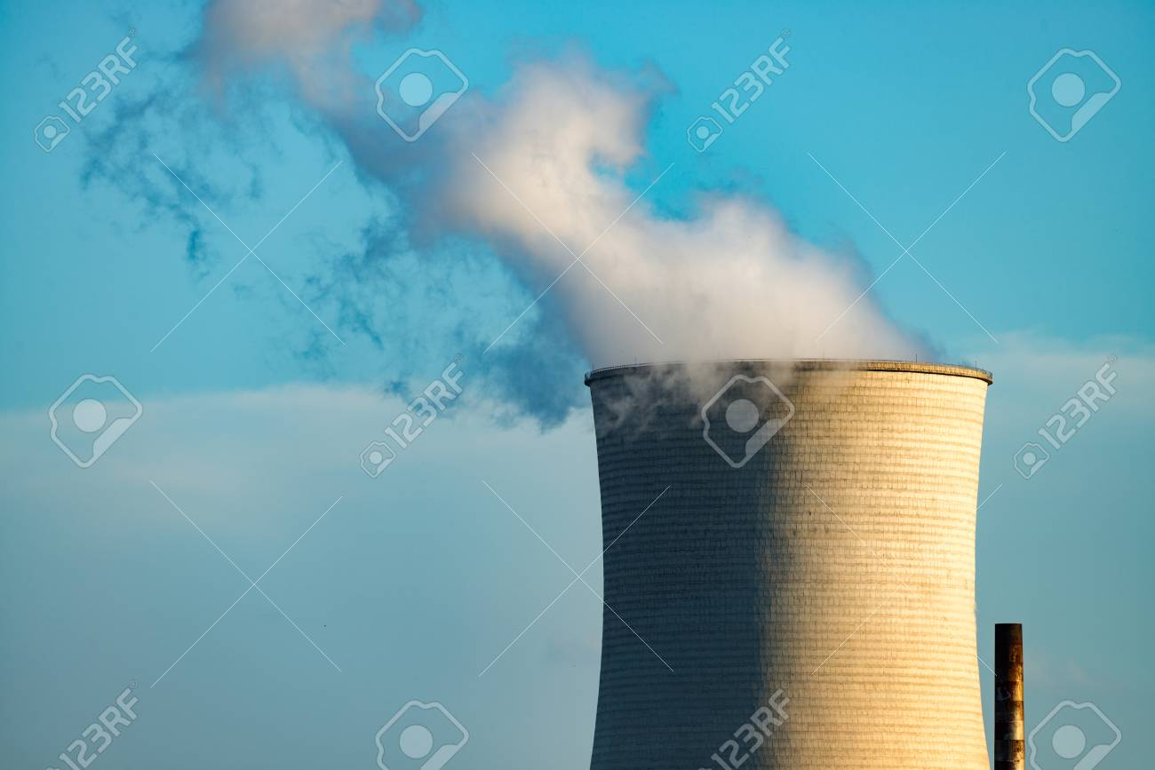 The smokestacks of coal-fired power plants in the blue sky background