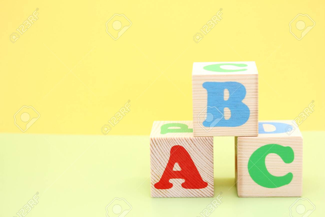 English ABC letters on wooden toy blocks. letters of the English alphabet. Learn foreign languages. English for beginners. Copy space. - 148023258
