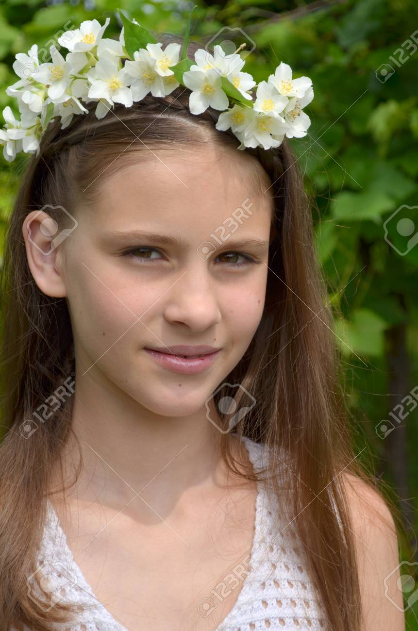 Girl With Fresh Flowers Of Jasmine In Her Hair Stock Photo Picture