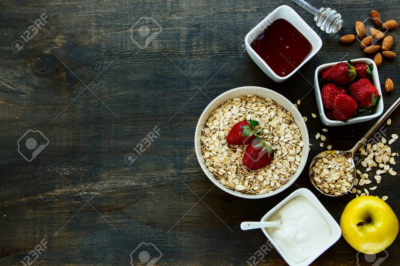 Healthy Breakfast. Yogurt with muesli and berries on rustic wooden background. Health and diet concept. Top view. - 46931641