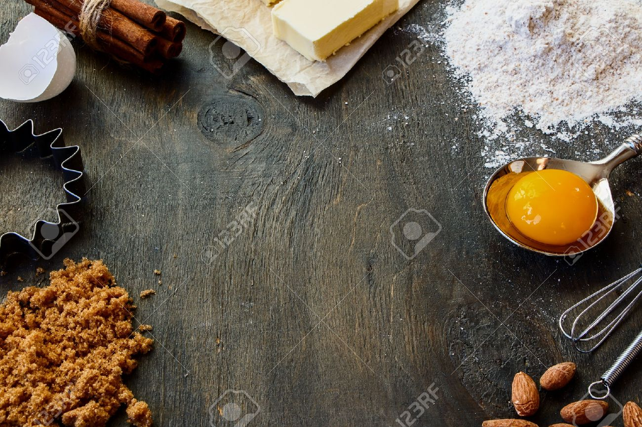 Baking ingredients - flour, sugar, egg, butter on vintage wood table. Top view. Rustic background with free text space. - 46932623