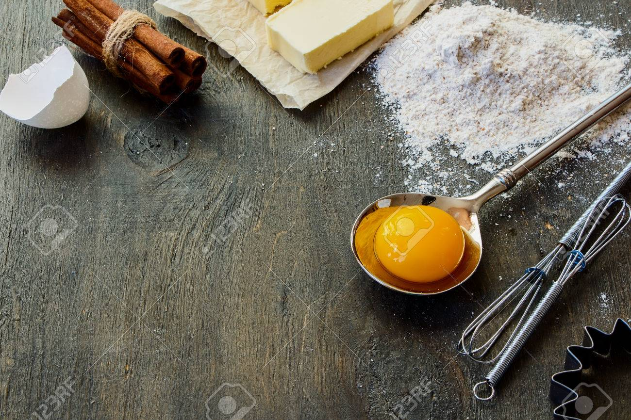 Cookies ingredients - dough recipe flour, sugar, egg, butter on vintage wood table. Rustic background with free text space. - 46932636