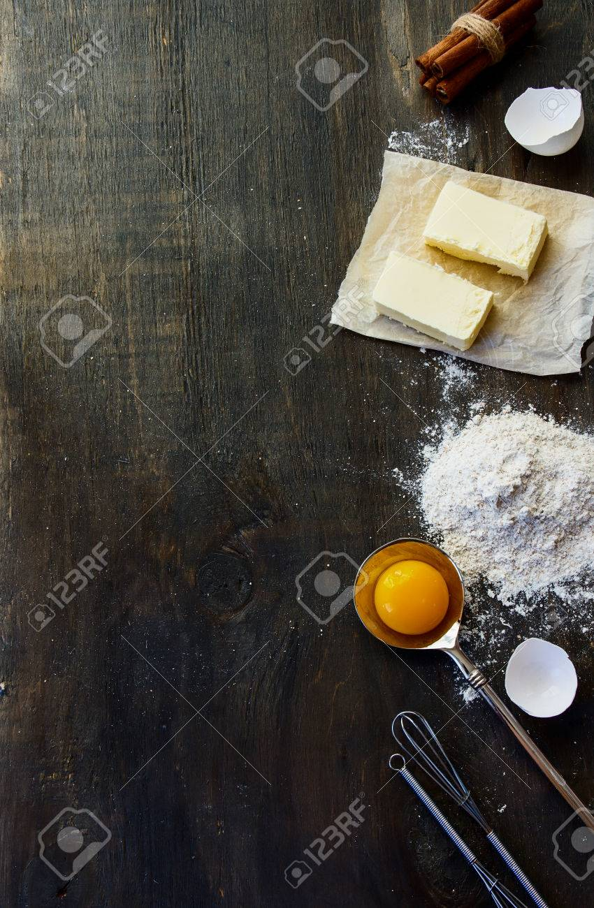Cookies ingredients - flour, sugar, egg, butter on vintage wood table. Top view. Rustic background with free text space. - 46933981
