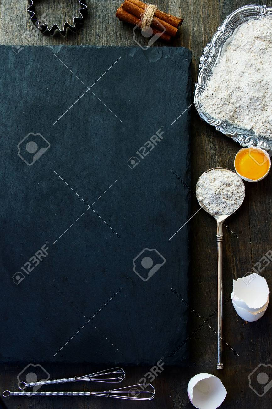 Baking background with raw eggs, eggshell, cinnamon and flour. Top view. Slate and wood background. Lots of copyspace. - 46934457