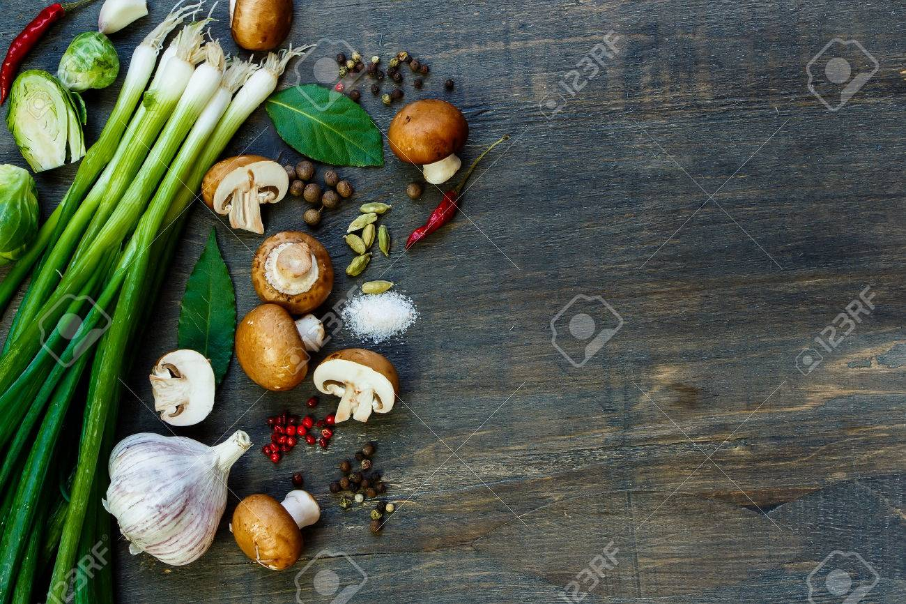 Top view of fresh mushrooms and ingredients on dark wooden table. Background with space for text - 47725486