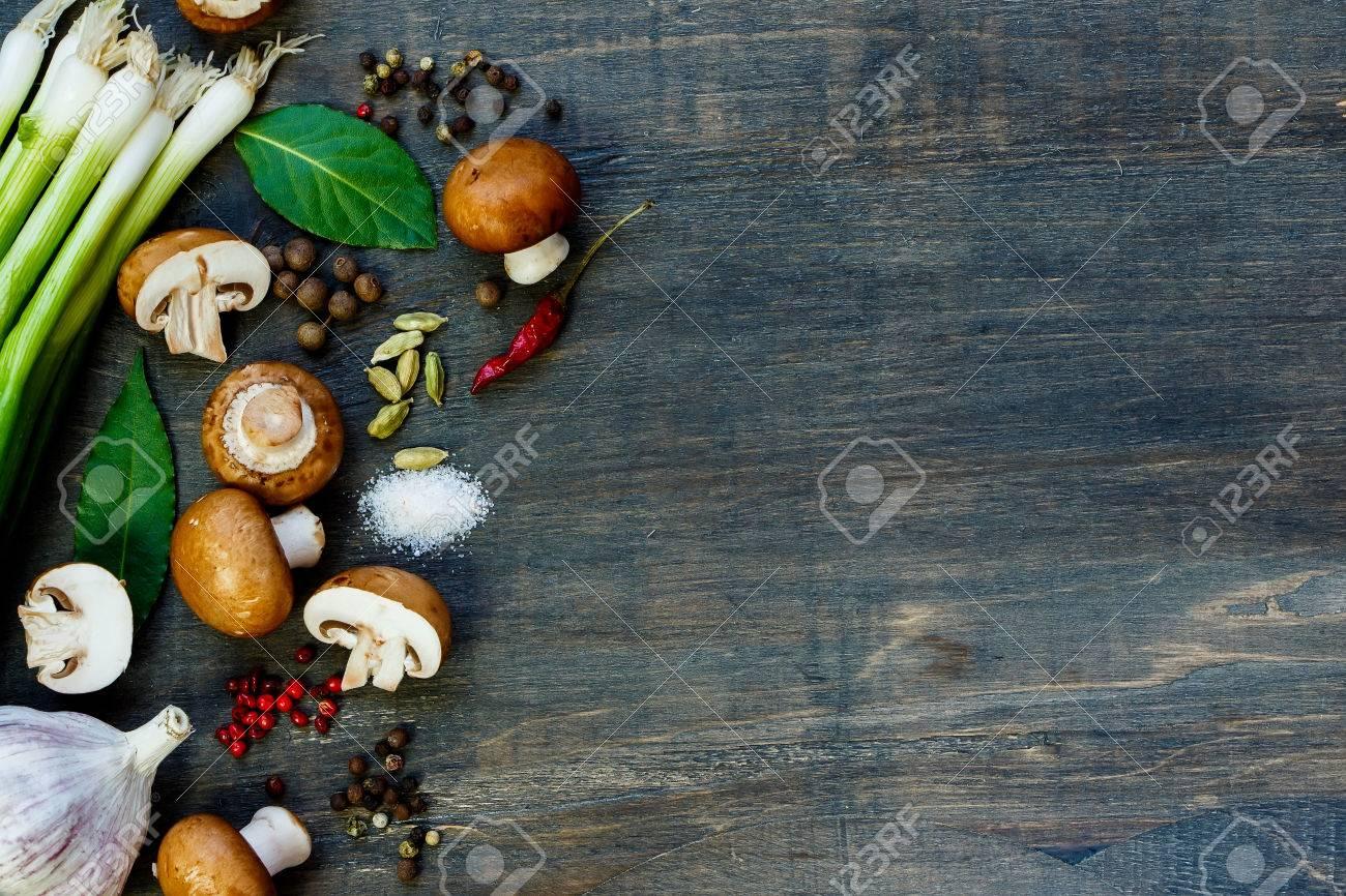 Fresh mushrooms and ingredients on dark wooden background - 47725400