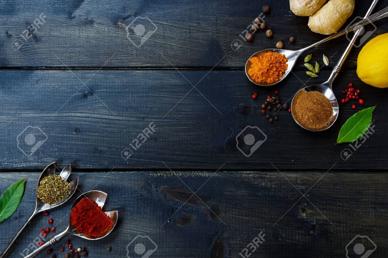 Background with herbs and spices selection on dark wooden table. Food or cooking concept. Top view. - 47984384