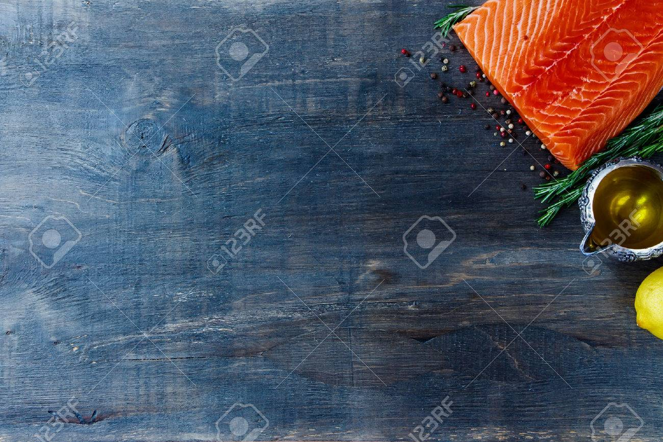 Seafood background. Raw fillet salmon, olive oil, aromatic spices and lemon. Space for text. Vegetarian food, health or cooking concept. Top view. - 47984480