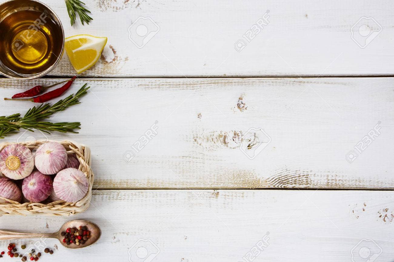 Garlic, herbs and spices selection on white wooden background withs space for text. Cooking, food or health concept. - 47984545