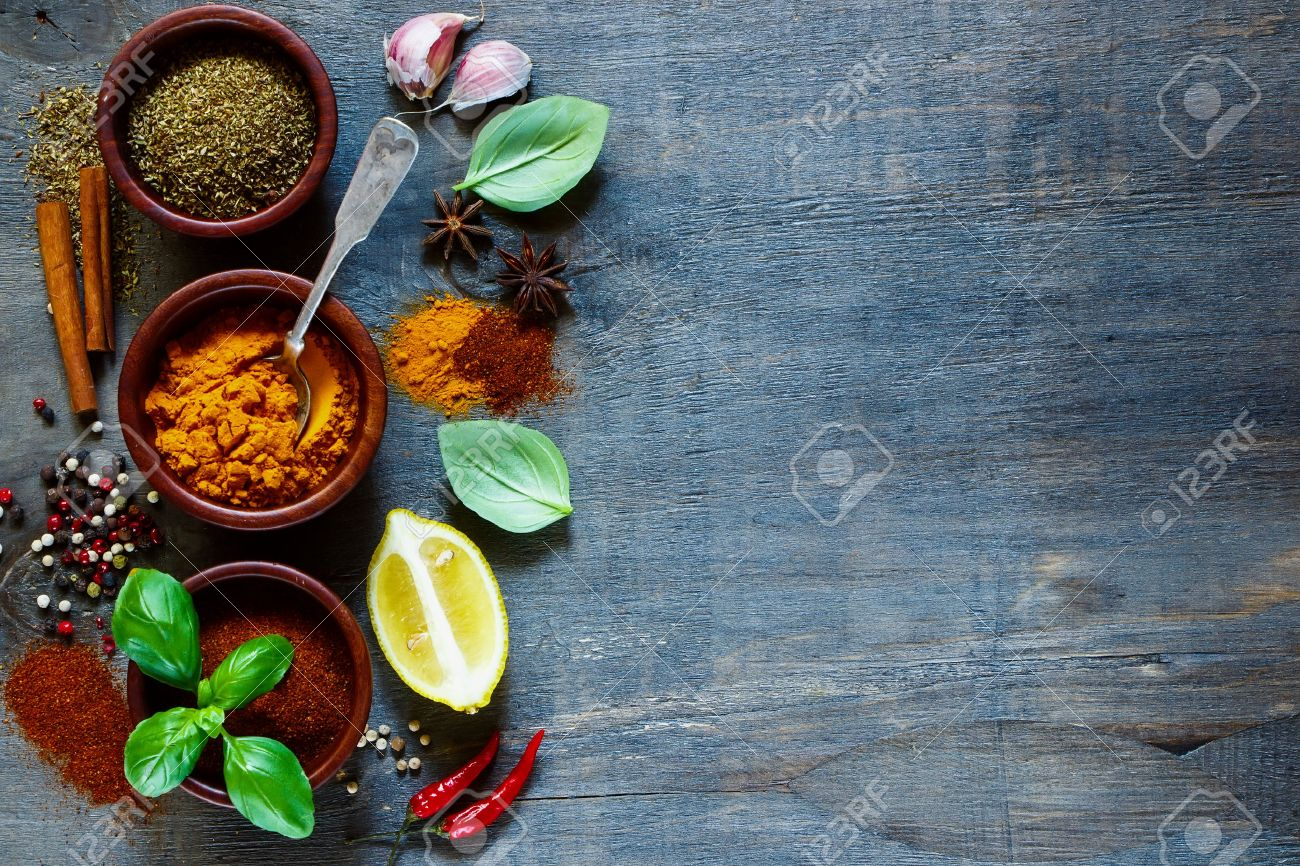 Various kind of spices and herbs over dark old wood. Food and cuisine ingredients. Background with space for text. - 49746331