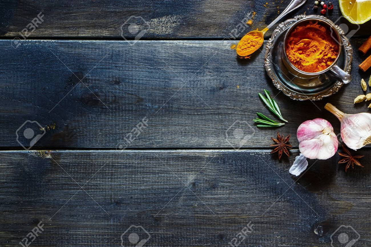 Fresh herbs and spices selection over old wood. Turmeric in a vintage cup on dark vintage background with space for text. Top view. - 49744533