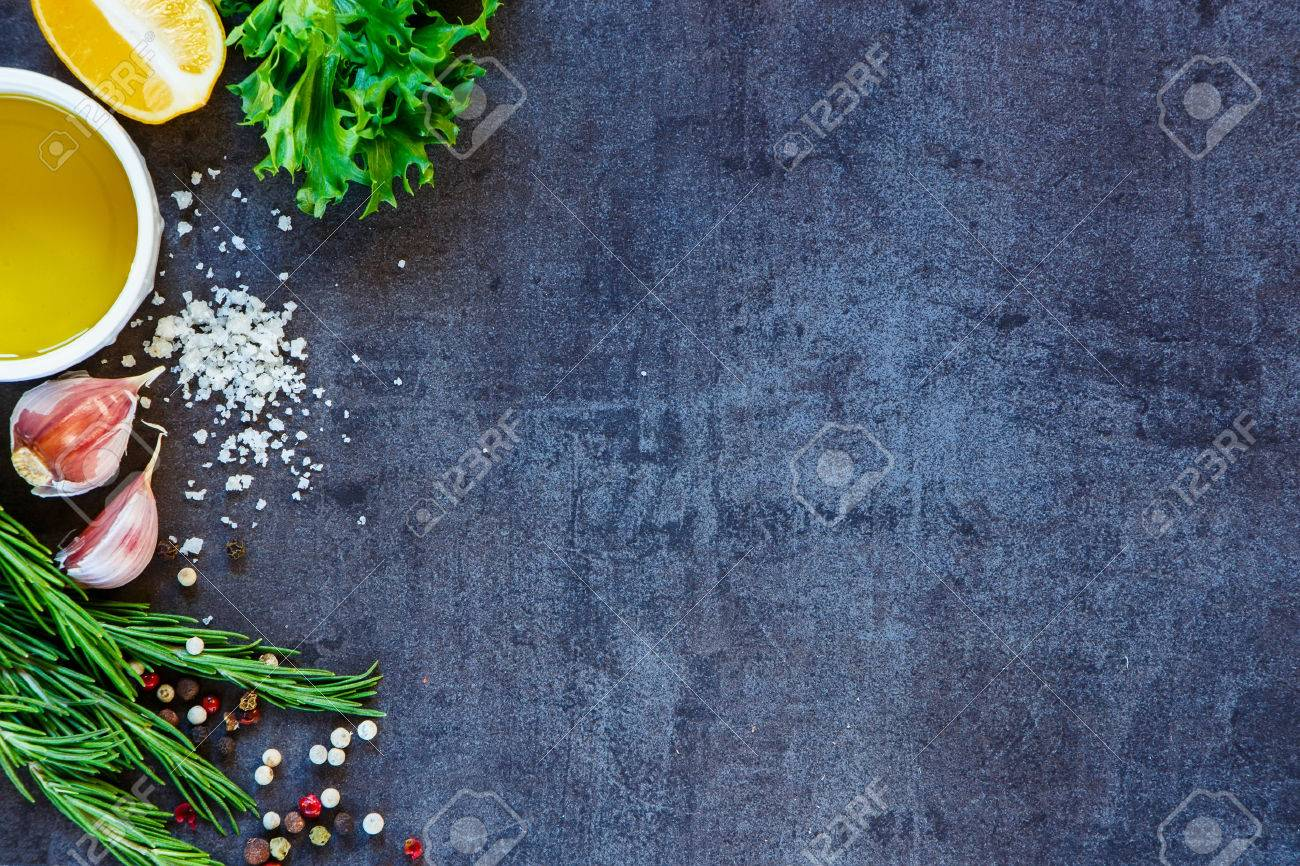 Delicious ingredients and seasoning for healthy vegetarian cooking on dark vintage background. Top view. Copy space. - 54733286