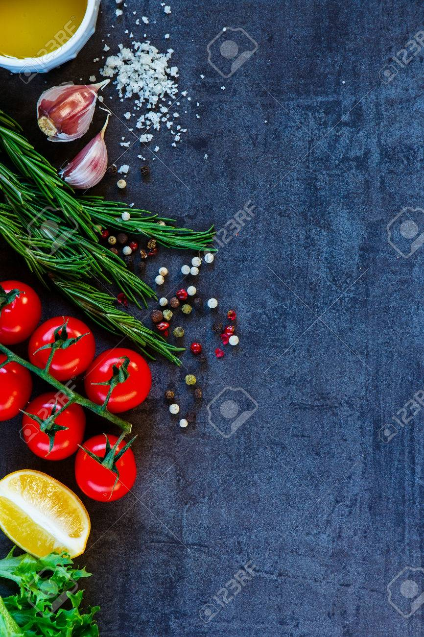 Delicious vegetables ingredients and seasoning for healthy vegetarian cooking on dark vintage background. Top view. Copy space. - 54733300