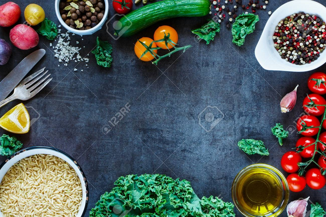 Brown rice with fresh delicious vegetables and ingredients for tasty cooking on vintage dark background, top view. - 54733120