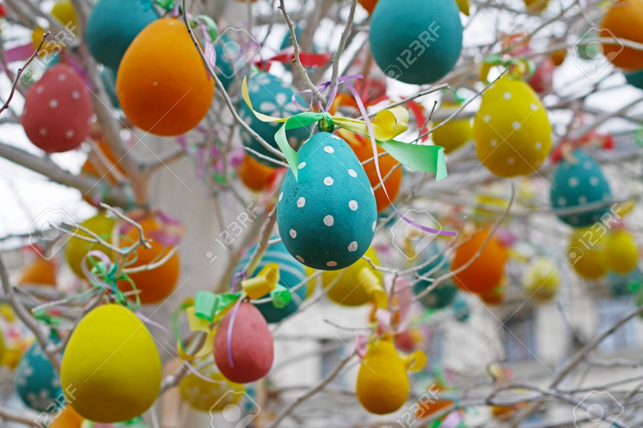 Colorful decorated easter eggs hanging on tree branches