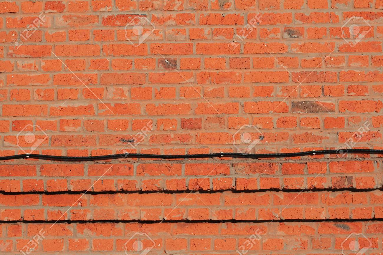Miraculous Red Brick Wall With Corrugated Pipe For Electrical Wiring As Stock Wiring 101 Akebretraxxcnl