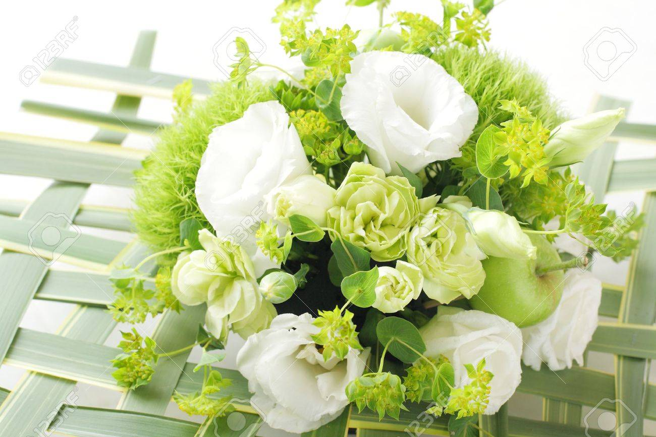 Bouquet From Different White Seasonal Flower And Green In Basket