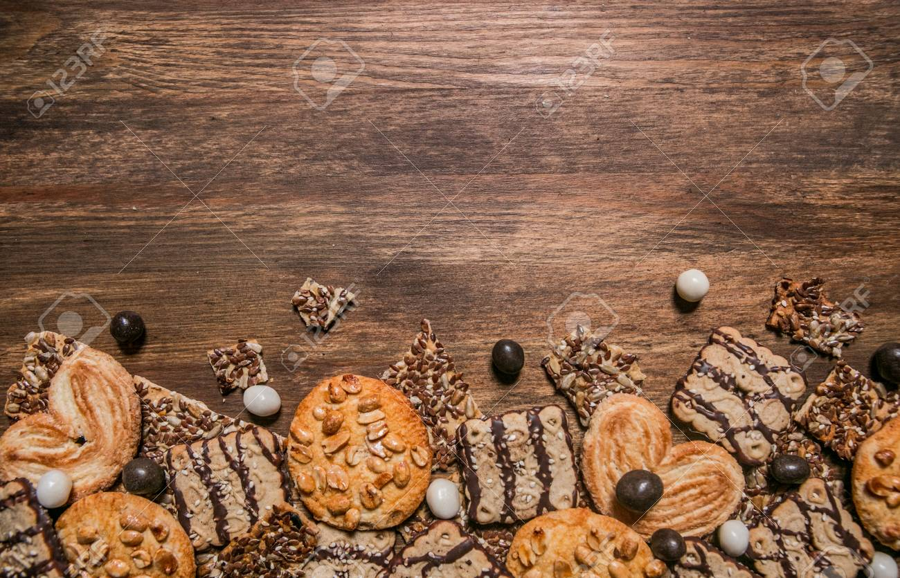 cookies with chocolate and sesame seeds on a wooden background