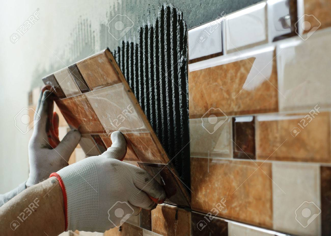 laying ceramic tiles tiler placing ceramic wall tile in position. Wall Tile For Kitchen How To Install  How To Install Kitchen