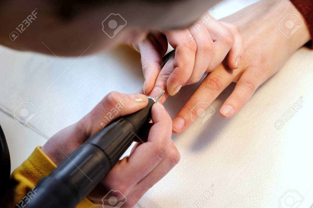 Hardware Manicure In A Beauty Salon. Manicurist Is Applying .. Stock ...