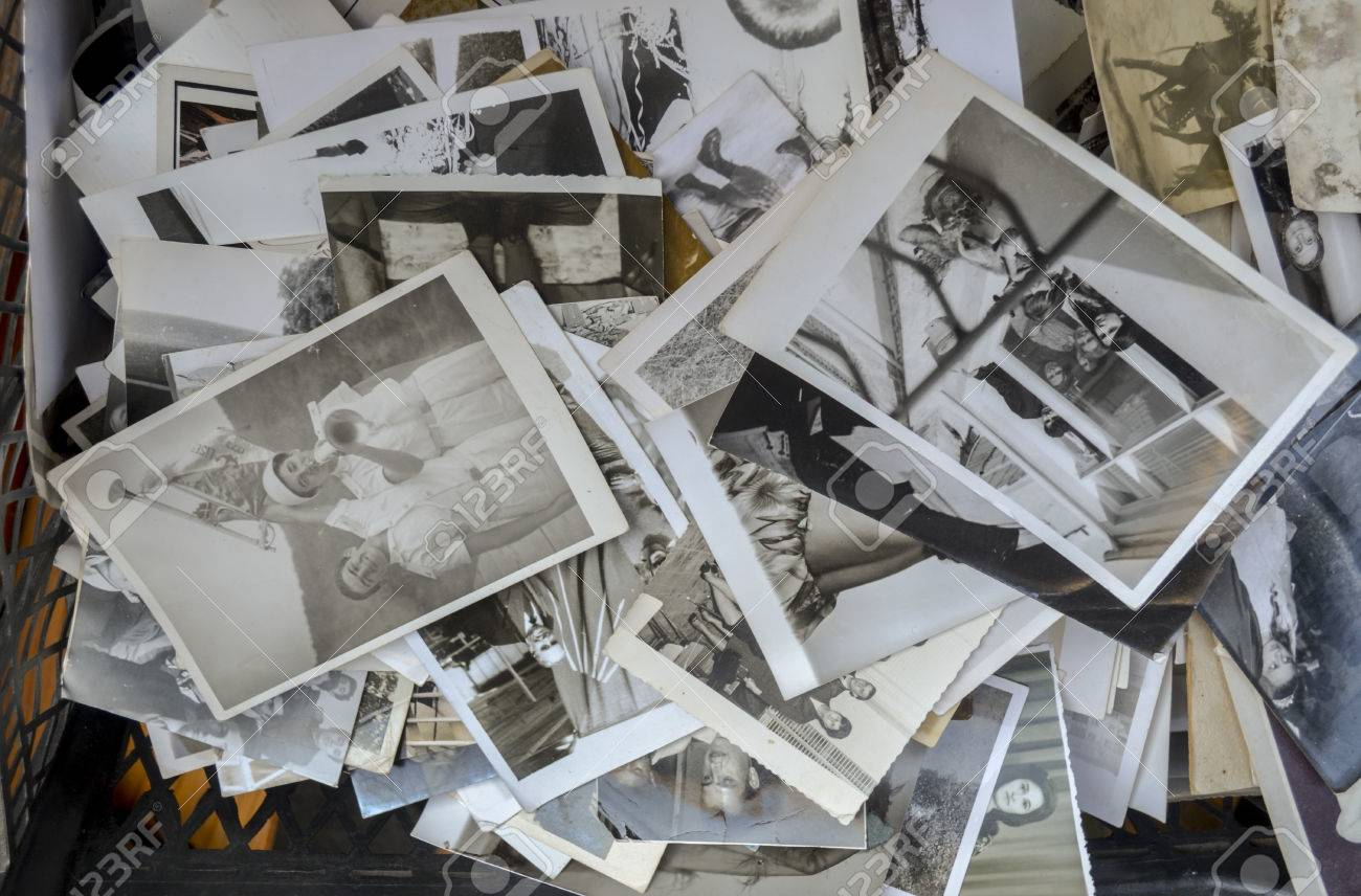 Derelict old photographs being sold at an antique shop in Istanbul, indifferent memories. - 35013629