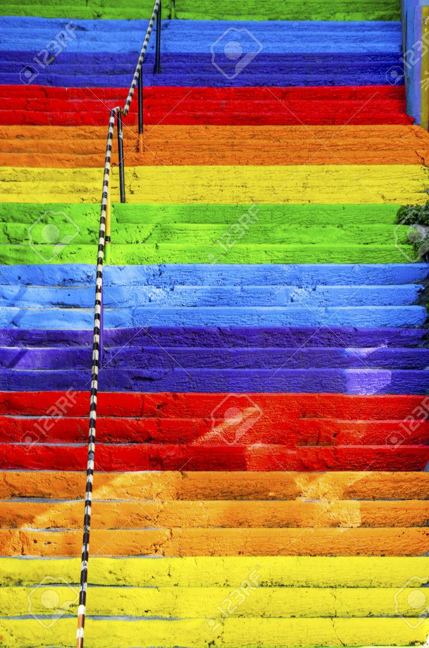 The concrete stairs on the street are painted in rainbow colors. Background - 70335825