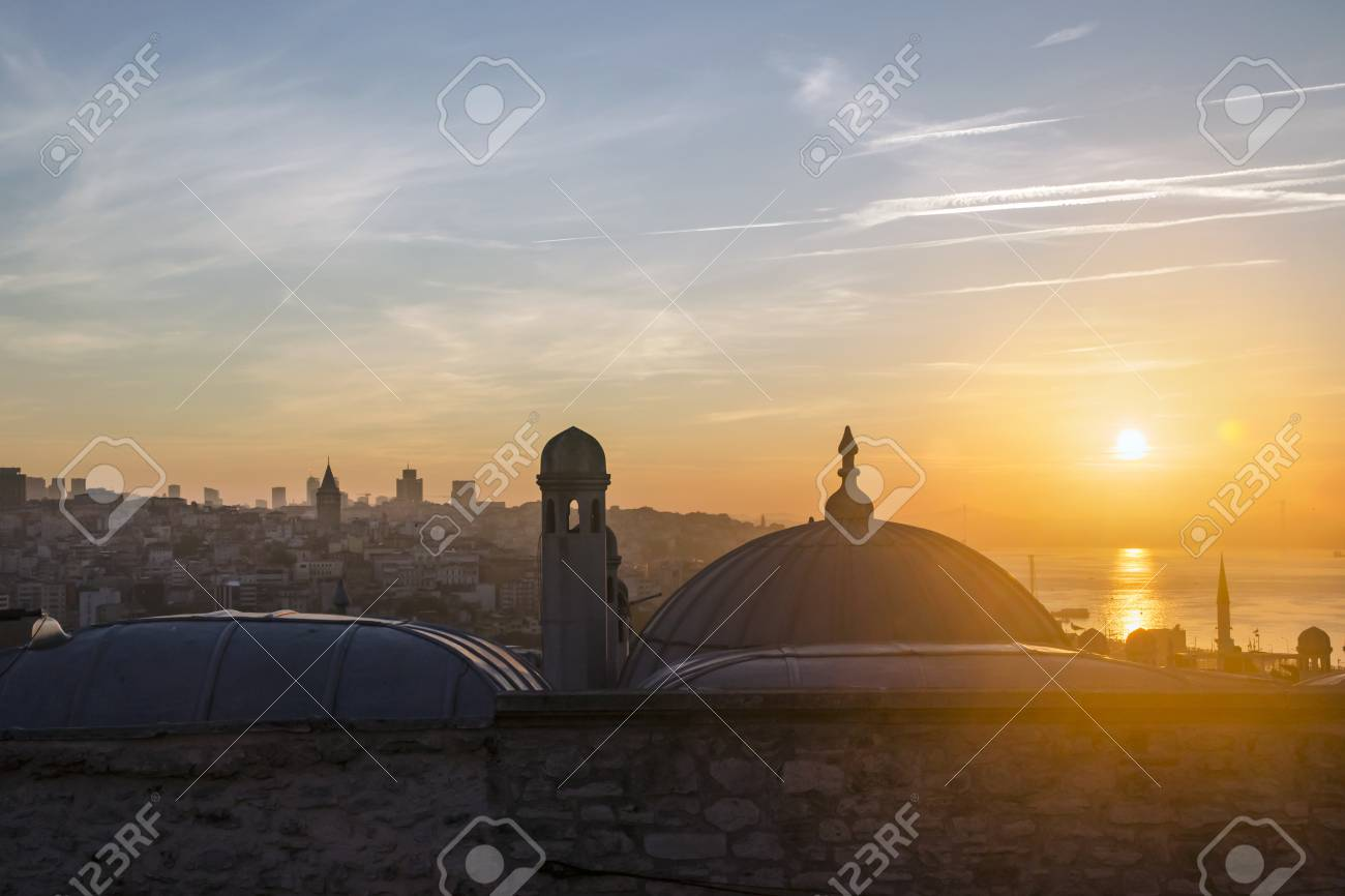 Suleymaniye Mosque from the garden Sunrise view of Istanbul. The sun rises through the throat of Istanbul. - 71373206
