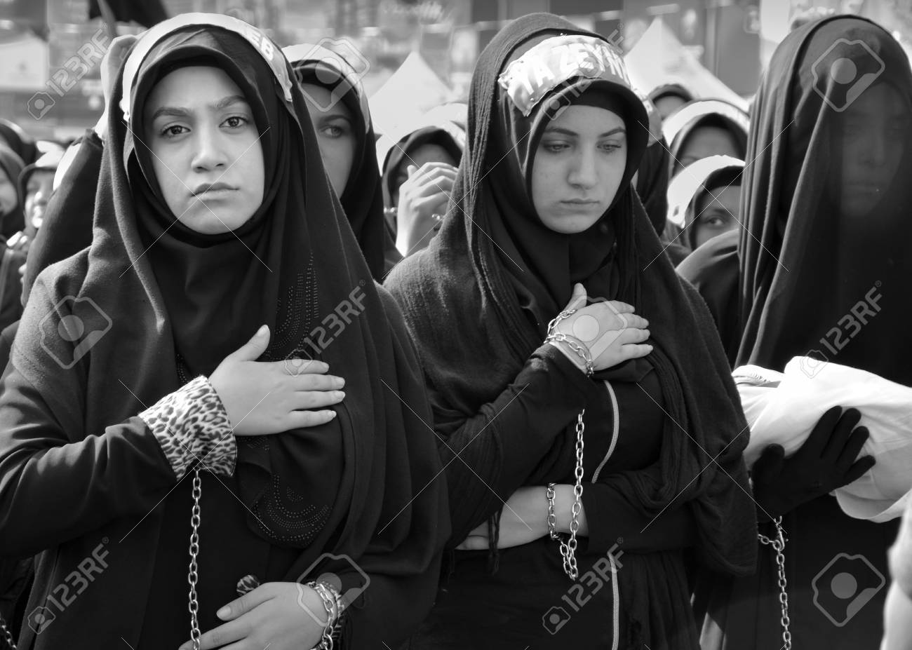 Istanbul, Turkey - October 11, 2016: Shia Muslim women mourn during Ashura. Turkish Shia Muslims mourning for Imam Hussain. Caferis take part in a mourning procession marking the day of Ashura in Istanbul's Kucukcekmece district, Turkey on October 11, 201 - 75291158