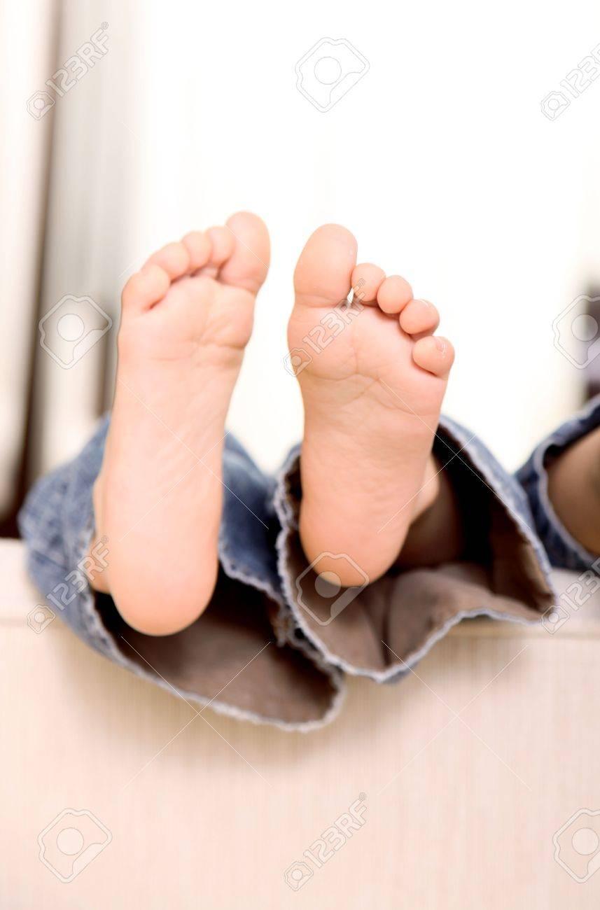 kid feet <b>Feet</b> of a child leaning on a sofa (<b>feet</b>, boy, <b>kid</b>)