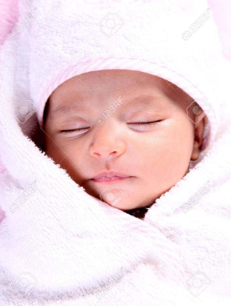 Beautiful baby on white blanket. Only face Stock Photo - 6001888