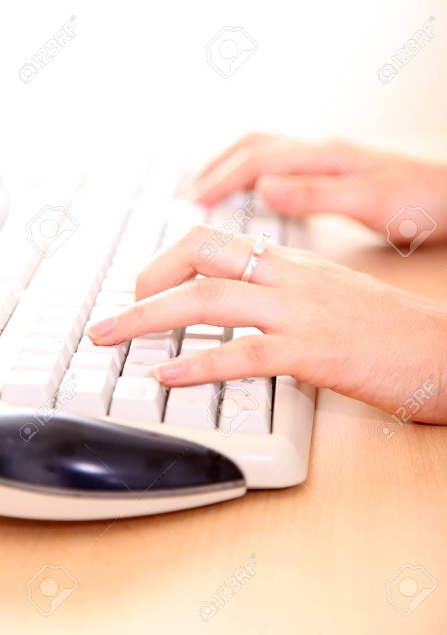 Hands of woman on a computer keyboard Stock Photo - 6008850