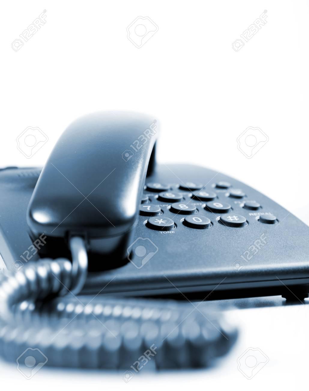Black telephone over white background. Communication object Stock Photo - 6008848