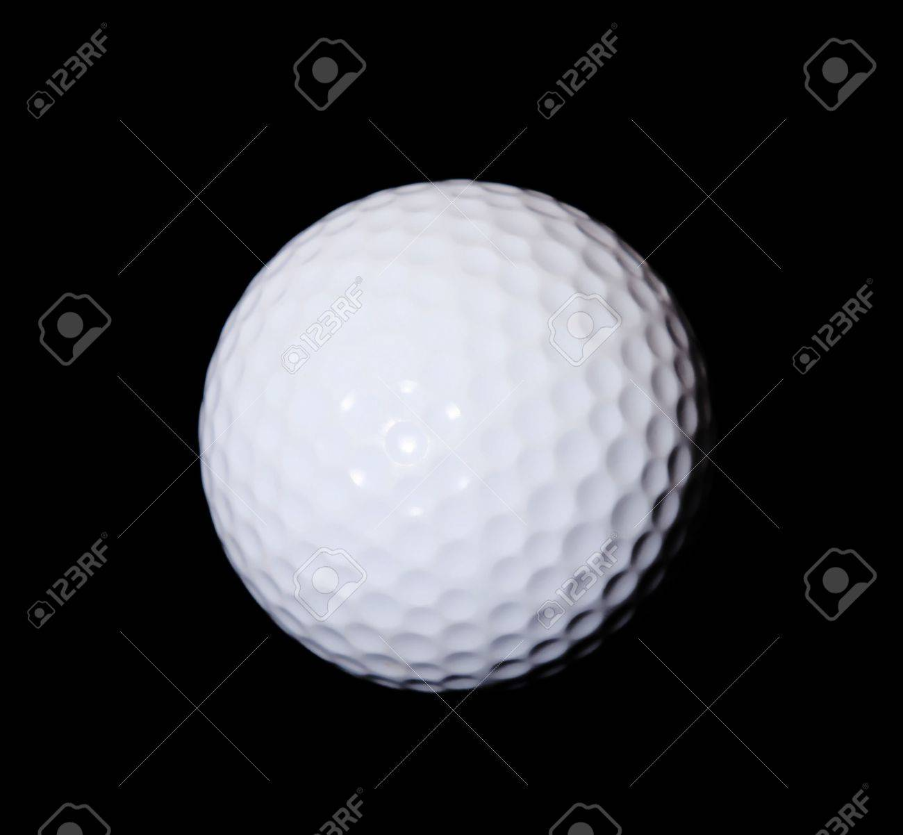 White golf ball over black background. Isolated image Stock Photo - 6069107