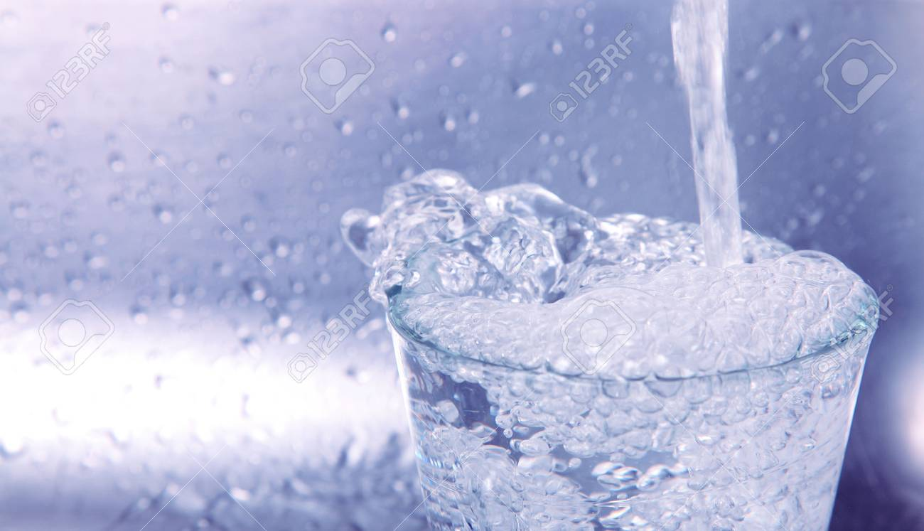 Water falling into a glass. Blue image Stock Photo - 6287203