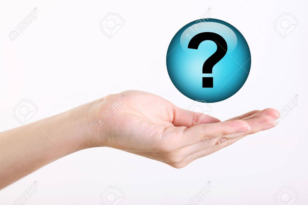 Hand holding a levitate question symbol over white background Stock Photo - 6365921
