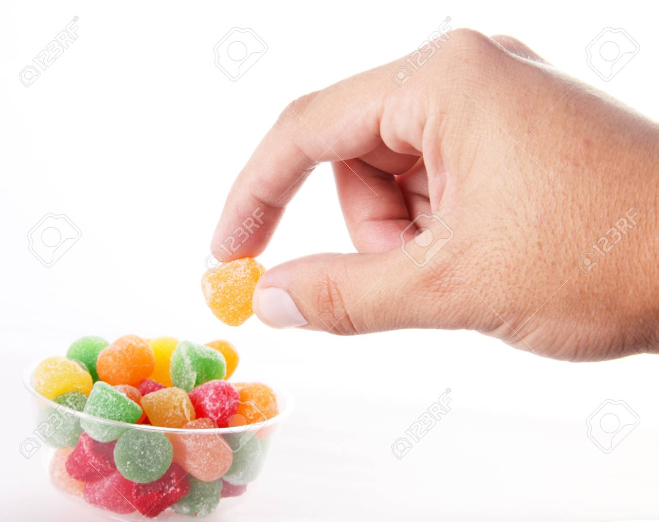 hand taking a candy over white background Stock Photo - 6582312