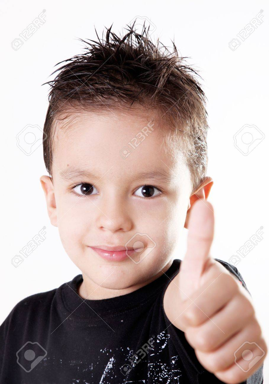 5 years old child doing a positive signal with his hand.ok attitude Stock Photo - 6598076