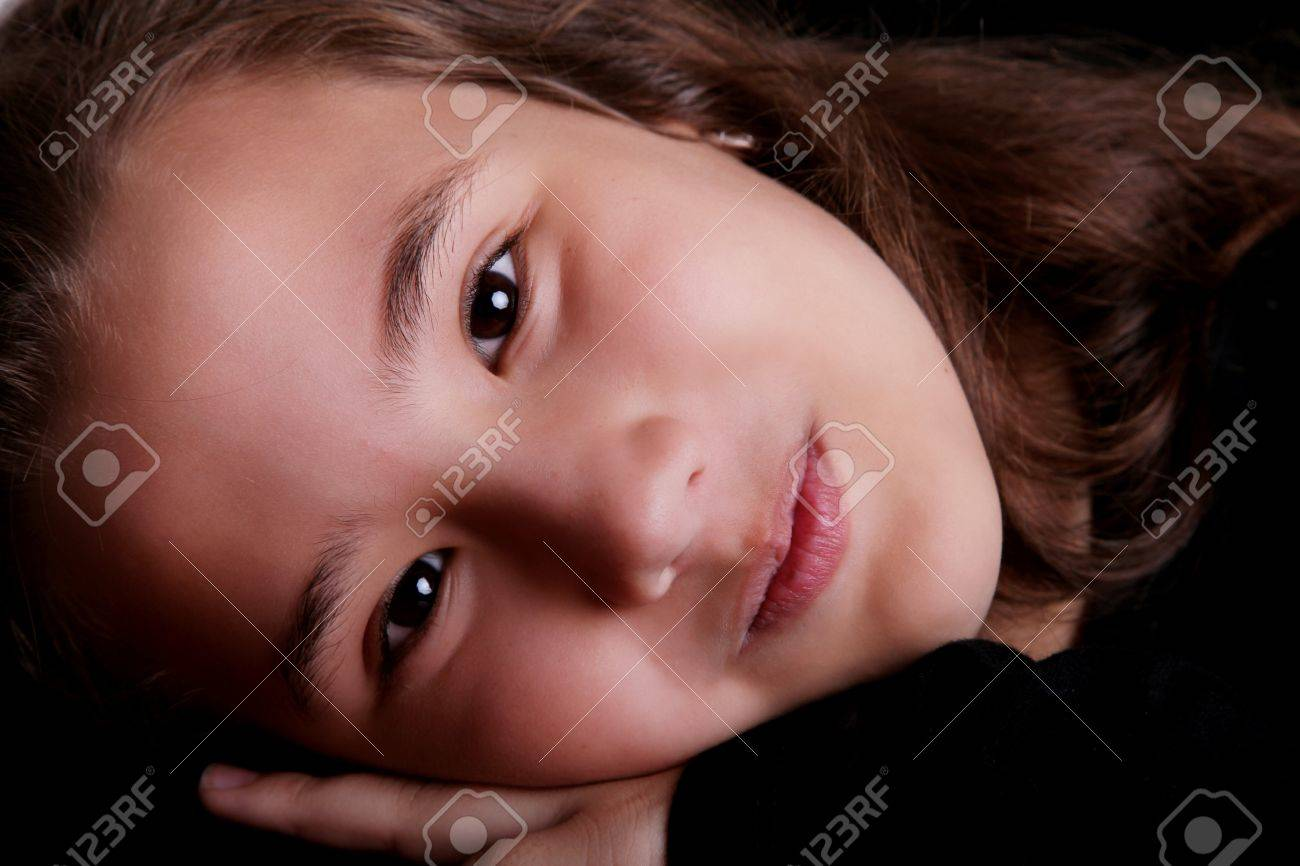Ten years old girl close up, looking at the camera. Stock Photo - 7267778