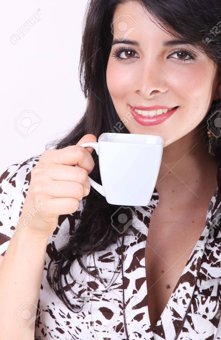 Woman drinking coffee in a white cup Stock Photo - 7549713