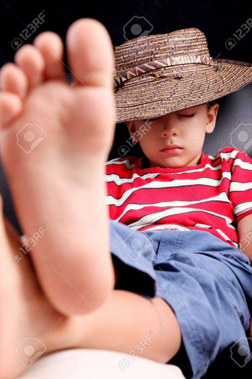 Five years old child sleeping with hat comfortably Stock Photo - 8646452