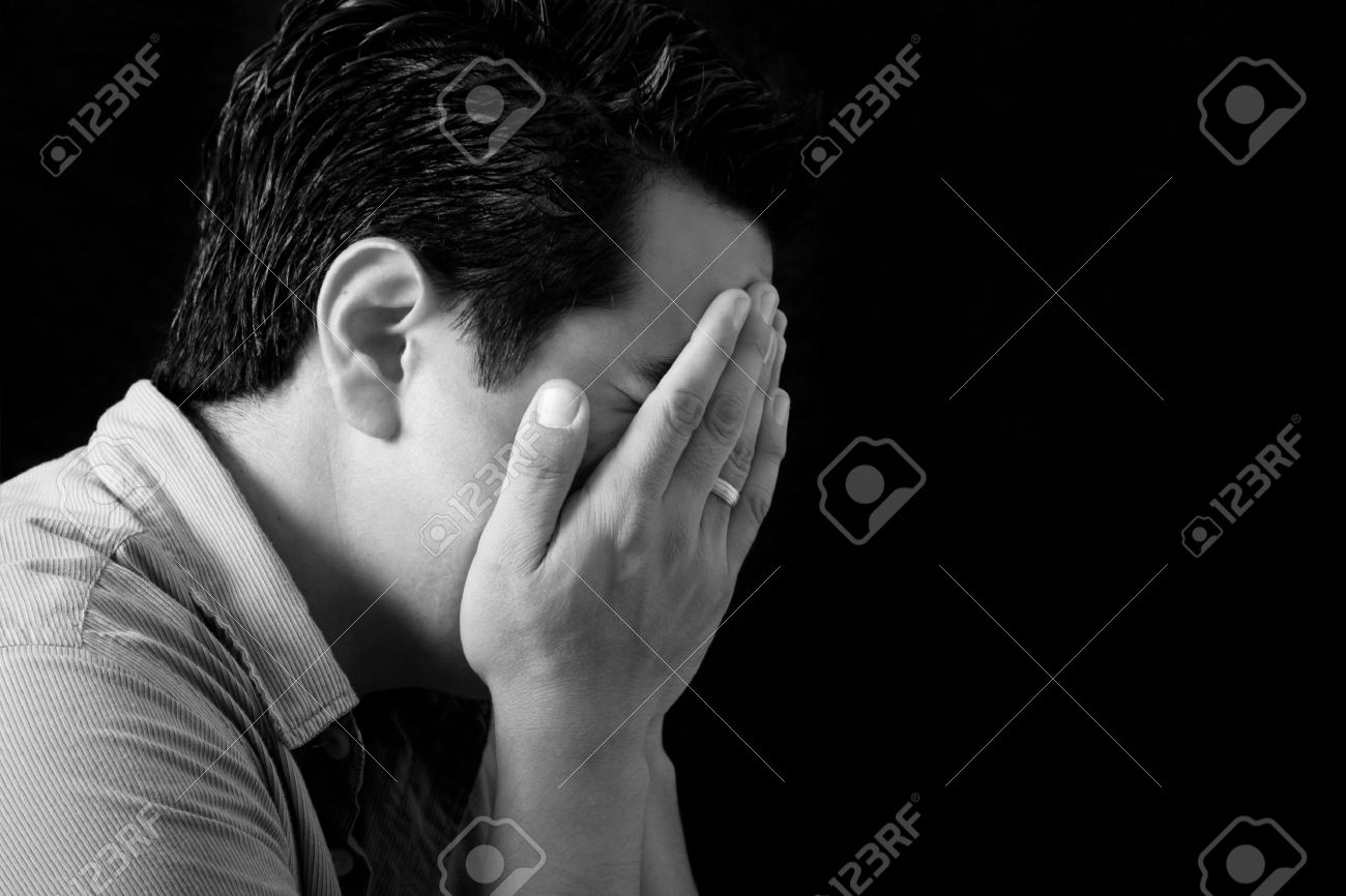 Man crying with his hands on his face in sorrow Stock Photo - 8912607