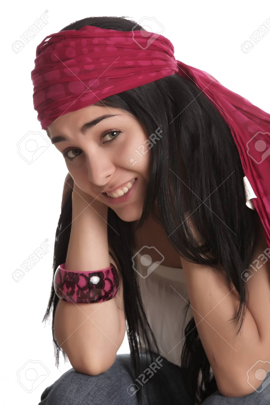 Desperate expression, young woman sitting looking at the camera, white background Stock Photo - 13440573