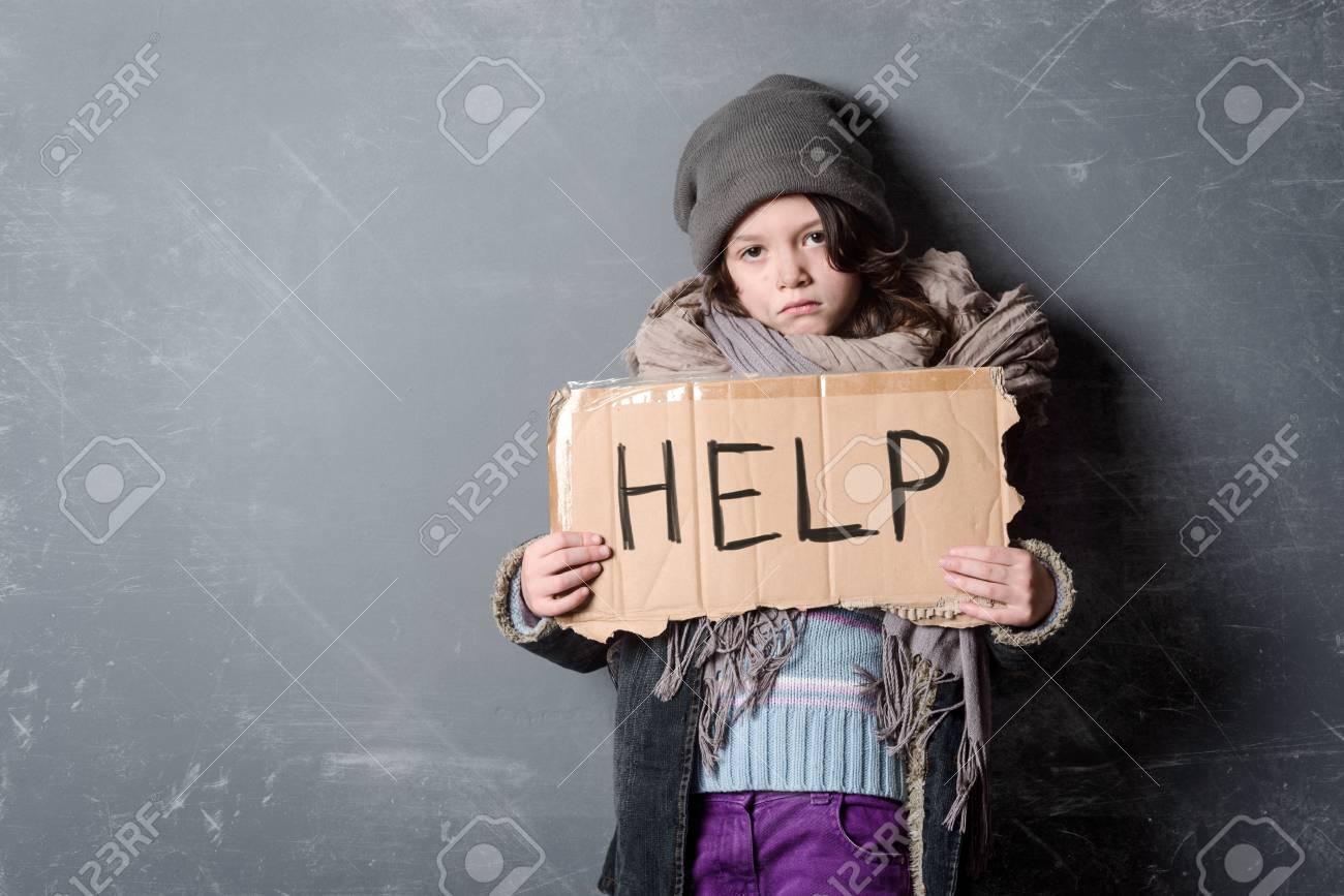Sad girl holding Help sign - 110837570