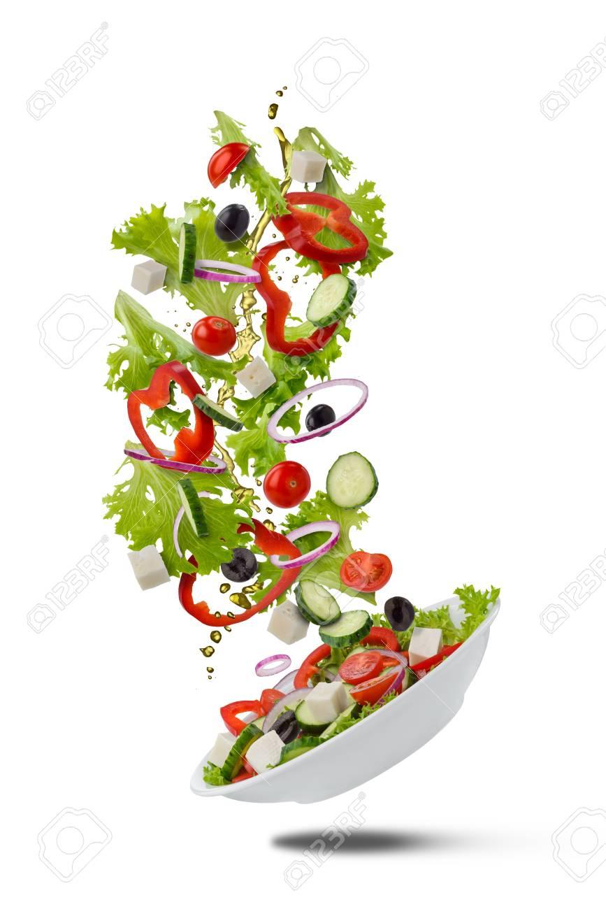 Flying Greek salad on white - 111179119