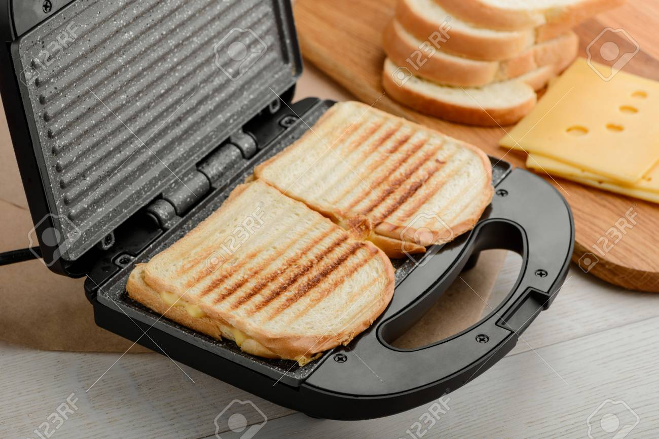 Grilled Sandwiches In Panini Maker Stock Photo Picture And Royalty Free Image Image 114927780