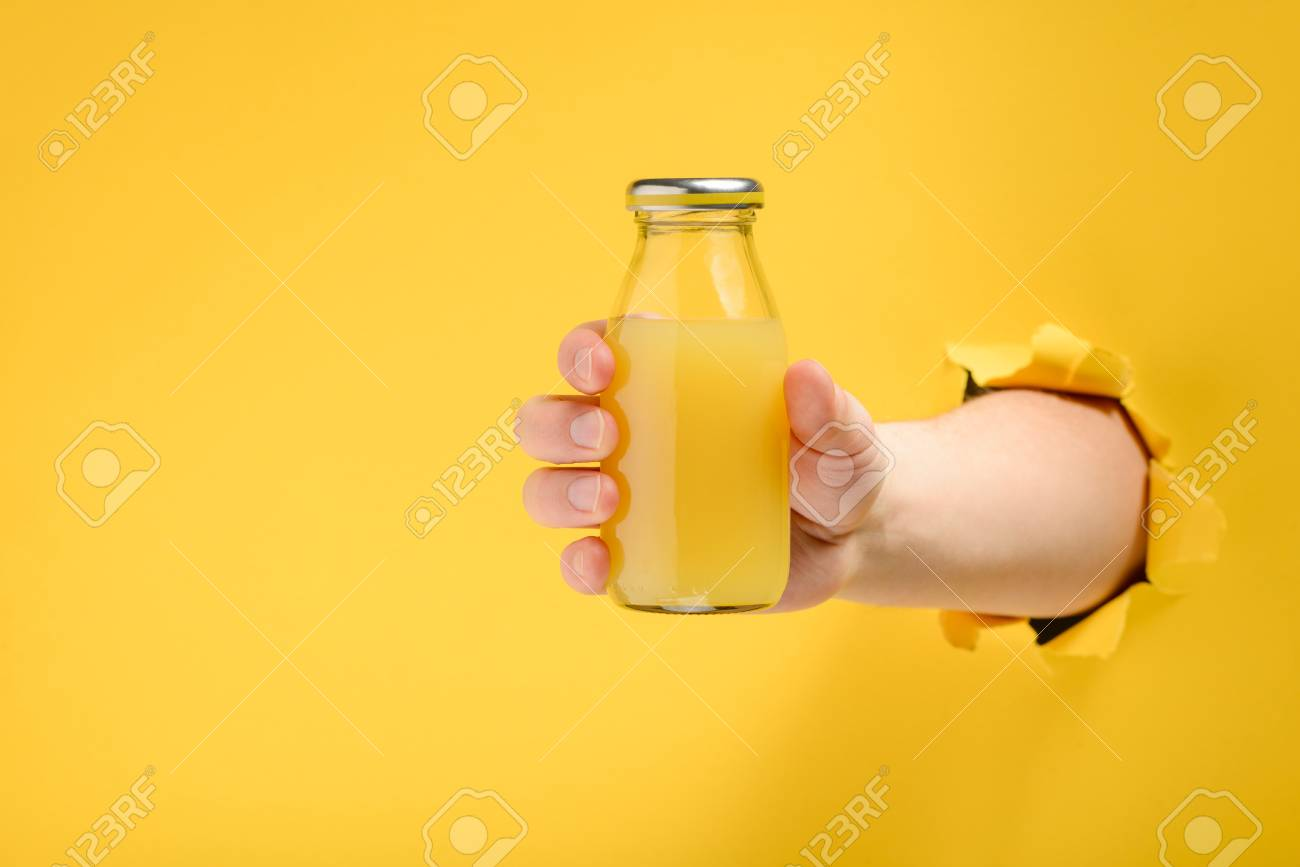 Hand holding a glass bottle - 118736495